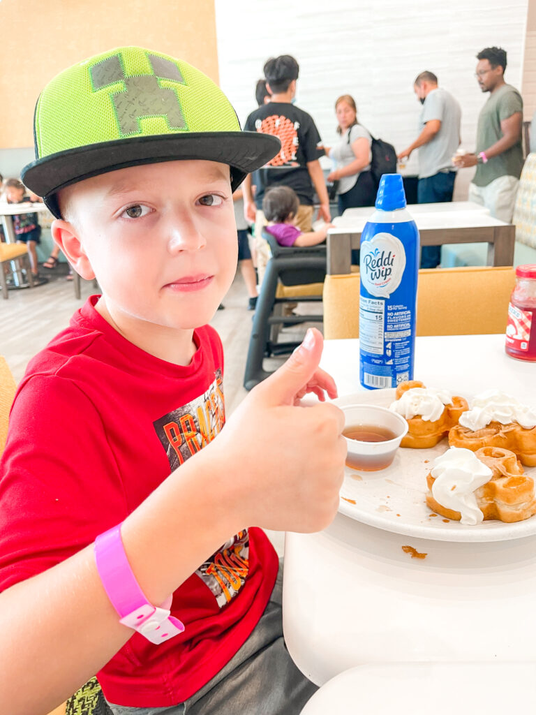 A boy eating Mickey Waffles at Cambria Hotel in Anaheim.