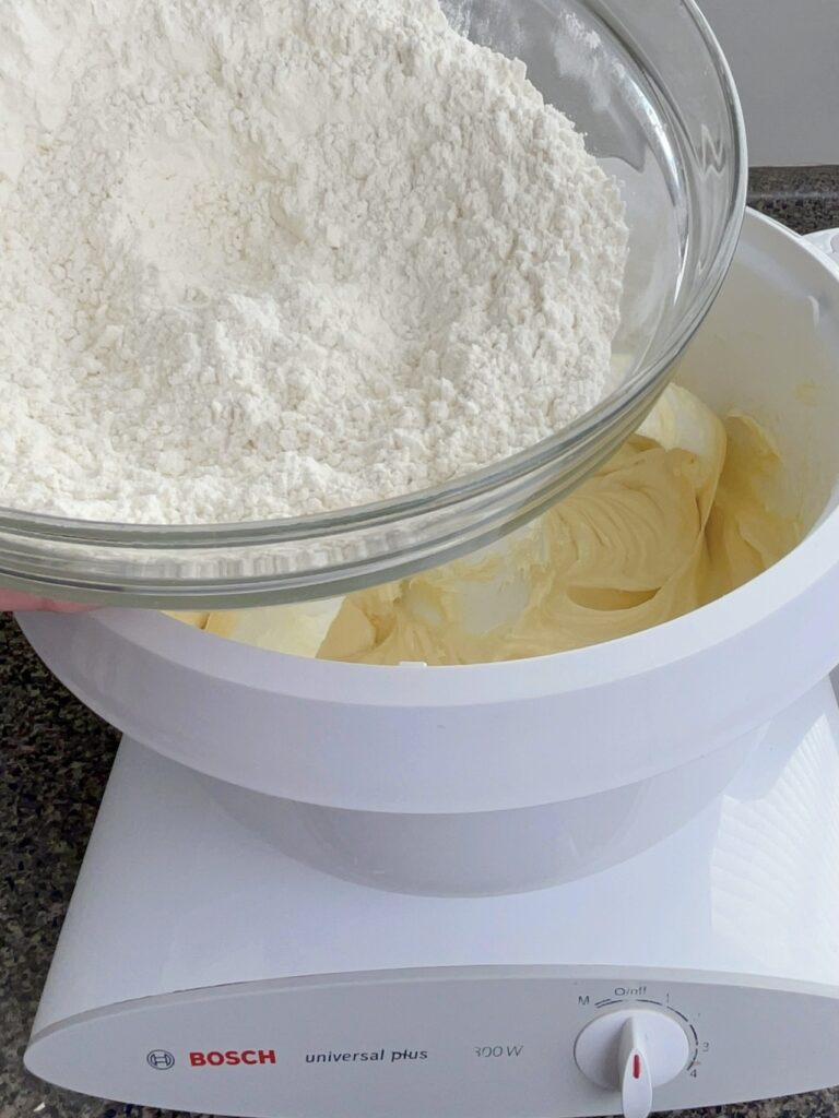 Dry and wet ingredients to makes sugar cookies.
