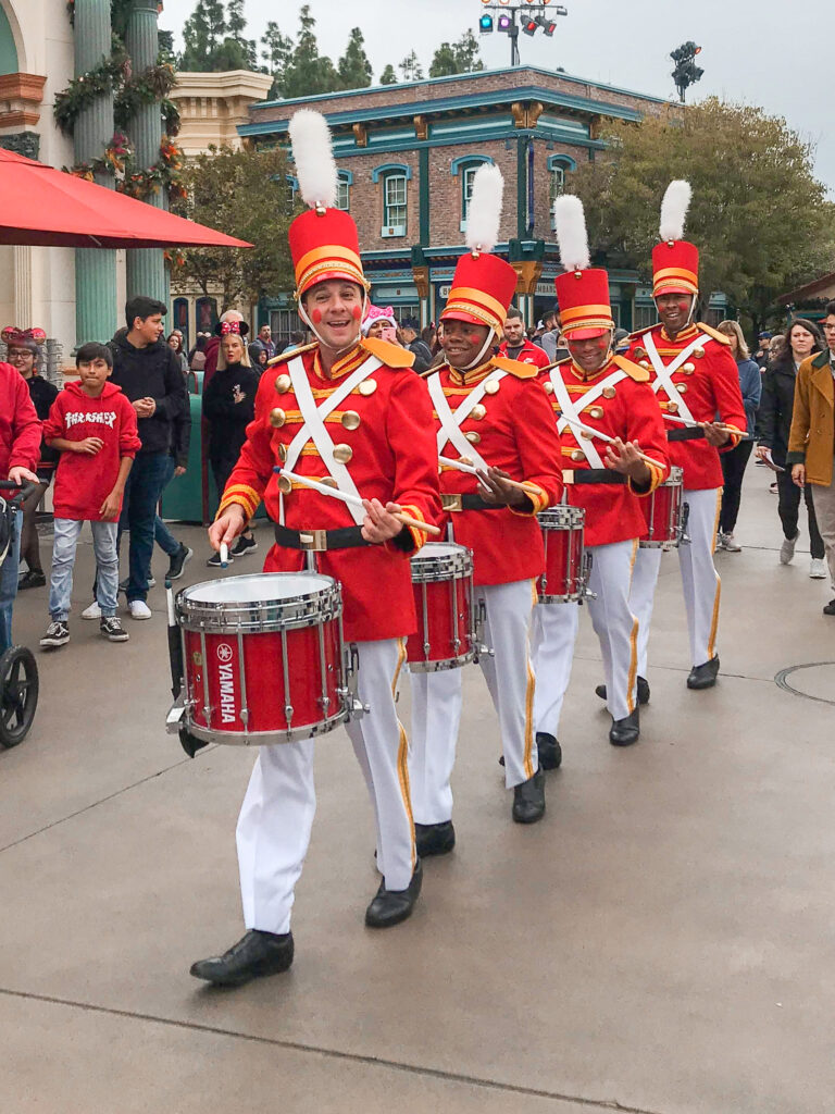 A marching band dressed like toy soldiers at Disneyland.