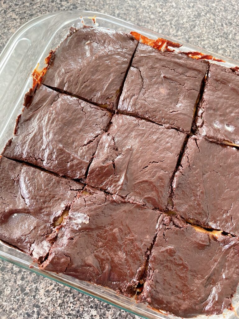 A pan of brownies topped with chocolate ganache.