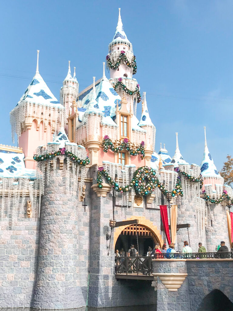 Sleeping Beauty Castle with holiday decorations.