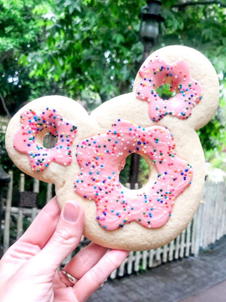Mickey Mouse shaped sugar cookie that looks like a donut.