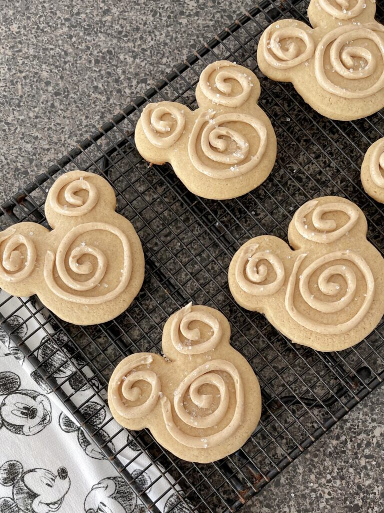 Mickey shaped churro sugar cookies on a cooling rack.