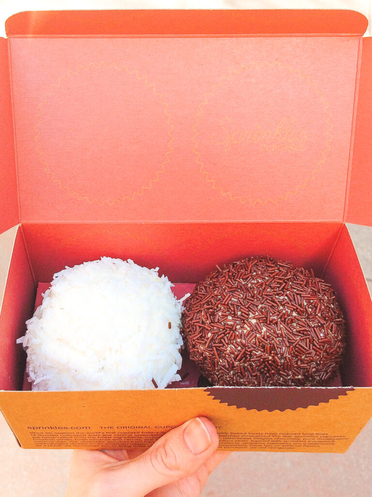 Two cupcakes from Sprinkles Cupcakes at Downtown Disney in California.